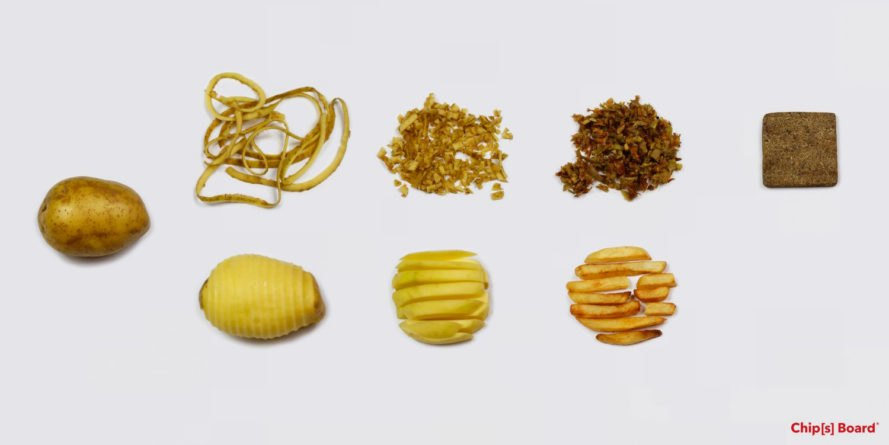 potatoes, potato peels, and building blocks made from potato waste on white background